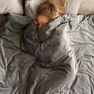 Sleeping Girl with Weighted Blanket